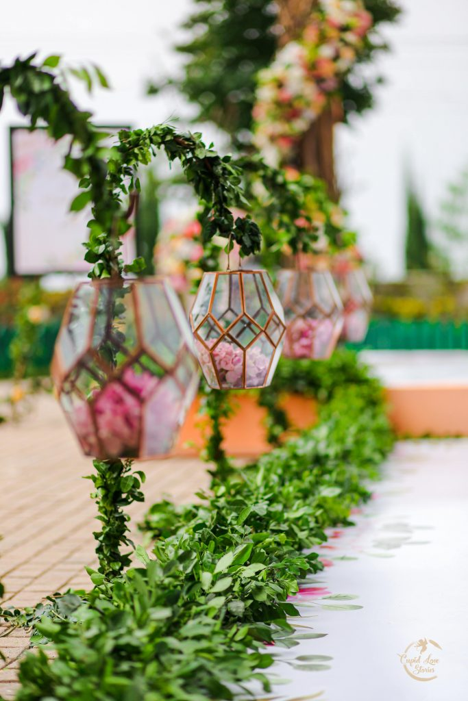 Picture of Rose Petals Filled Glass Terrariums Used in the Enchanted Garden Themed Decor at Aparna & Arnav's Destination Engagement Party