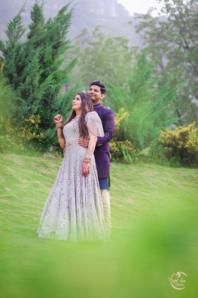 Aparna & Arnav's Couple Portrait Picture in JW Marriott Mussoorie Lawn amidst Beautiful Mountain Landscape