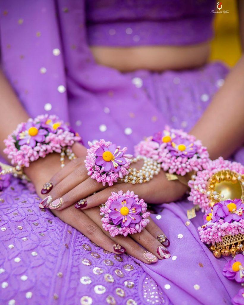 3d purple haldi ceremony nail art with purple flower jewellery