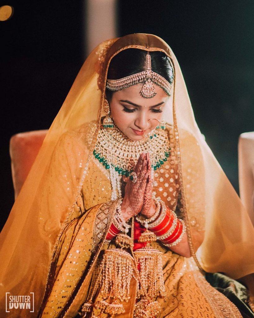 Mrighna's Solo Portrait in Gold Velvet Sabyasachi Lehenga from wedding rituals at her beach wedding in Dubai