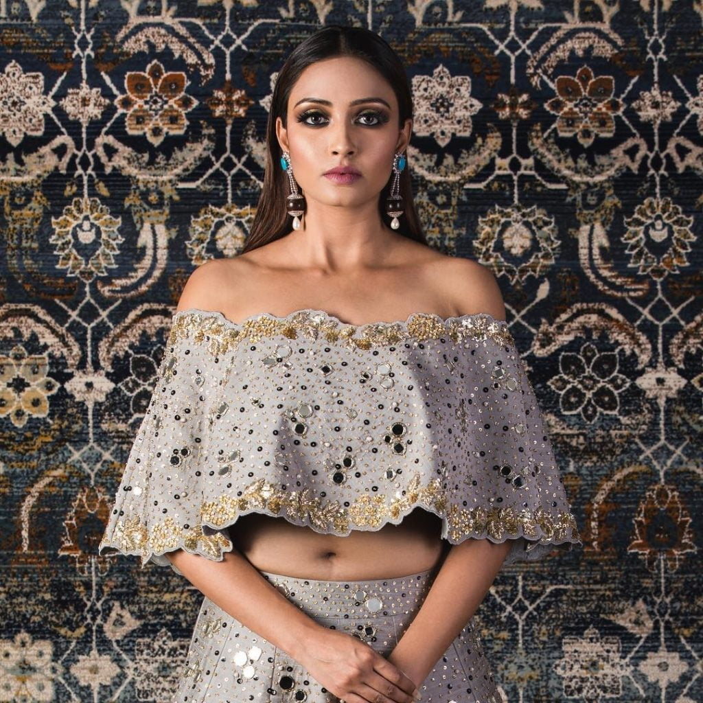Cape blouse with lehenga with scalloped edges and mirror details