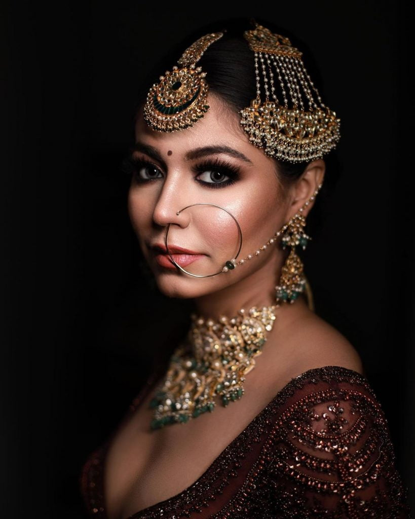 Charcoal black kohl bridal eye maekup with grey coloured lenses by House of Beauty By Sahil (1)