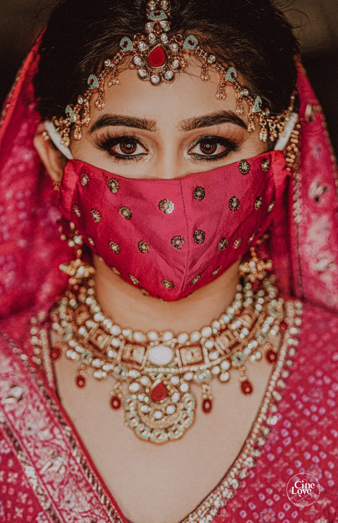bright hot pink wedding face mask with kohl eyes