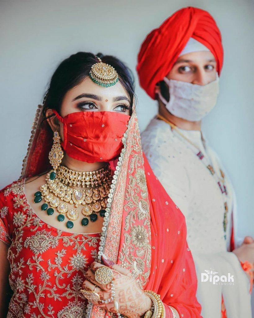 couple posing with wedding simple face masks