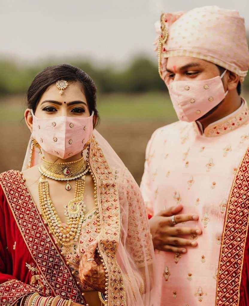 couple pastel pink wedding face masks photograph