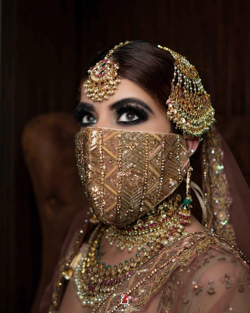Jeweled and sequined heavy golden bridal face masks for Indian brides