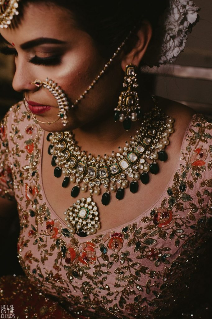Bridal Solo Portrait of Palak in her designer bridal dresses and kundan jewelry