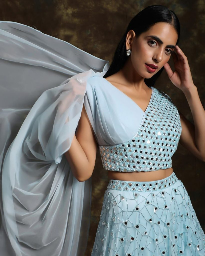Light blue lehenga blouse design with surplice neck.