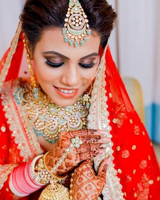 Mansi Lakhwani's glossy pink and caramel eye makeup