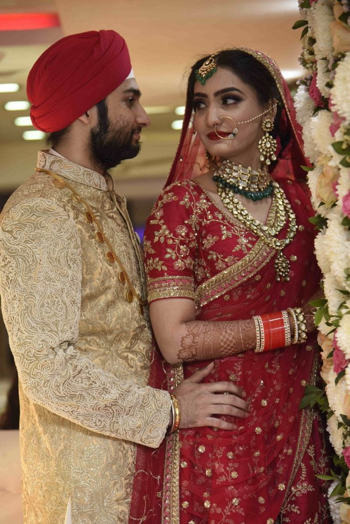Maroon color lehenga and a golden sherwani make great color coordinated outfits.