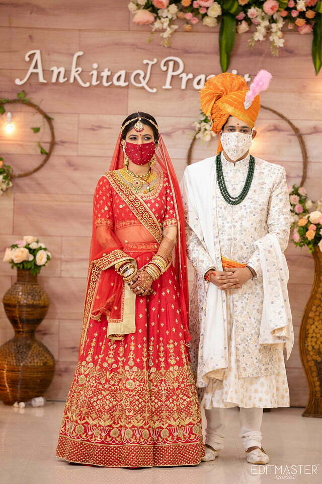 Indian Couples wearing coordinated face masks with outfits