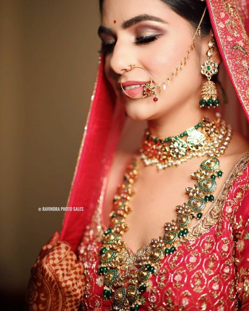 Metallic gold and brick red cut crease bridal eye makeup by Ravindra Photo Sales
