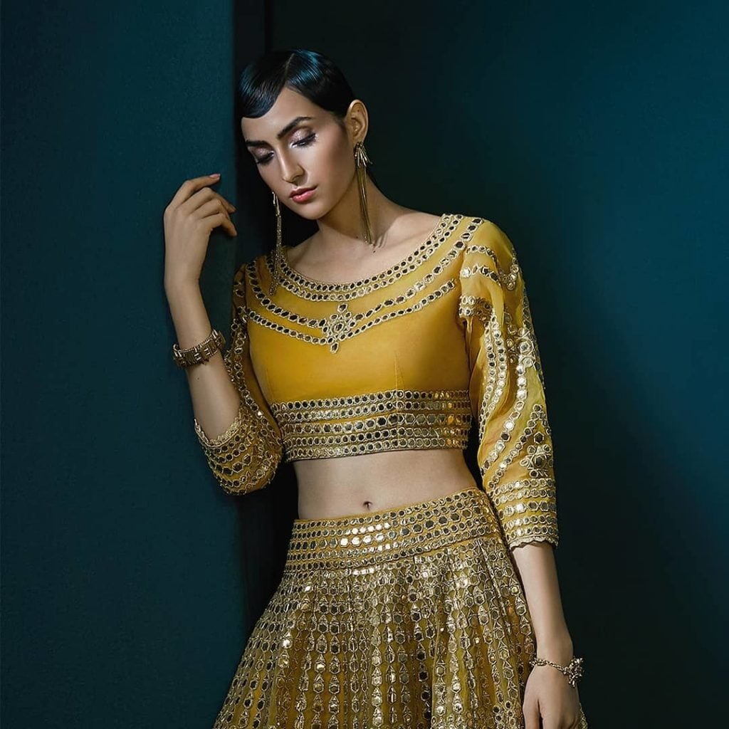 Mirror work lehenga design with U-neck and sleeves.