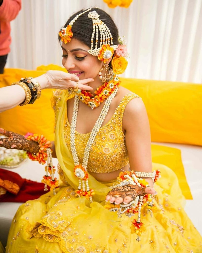 Mustard yellow heavy embellished lehenga blouse.
