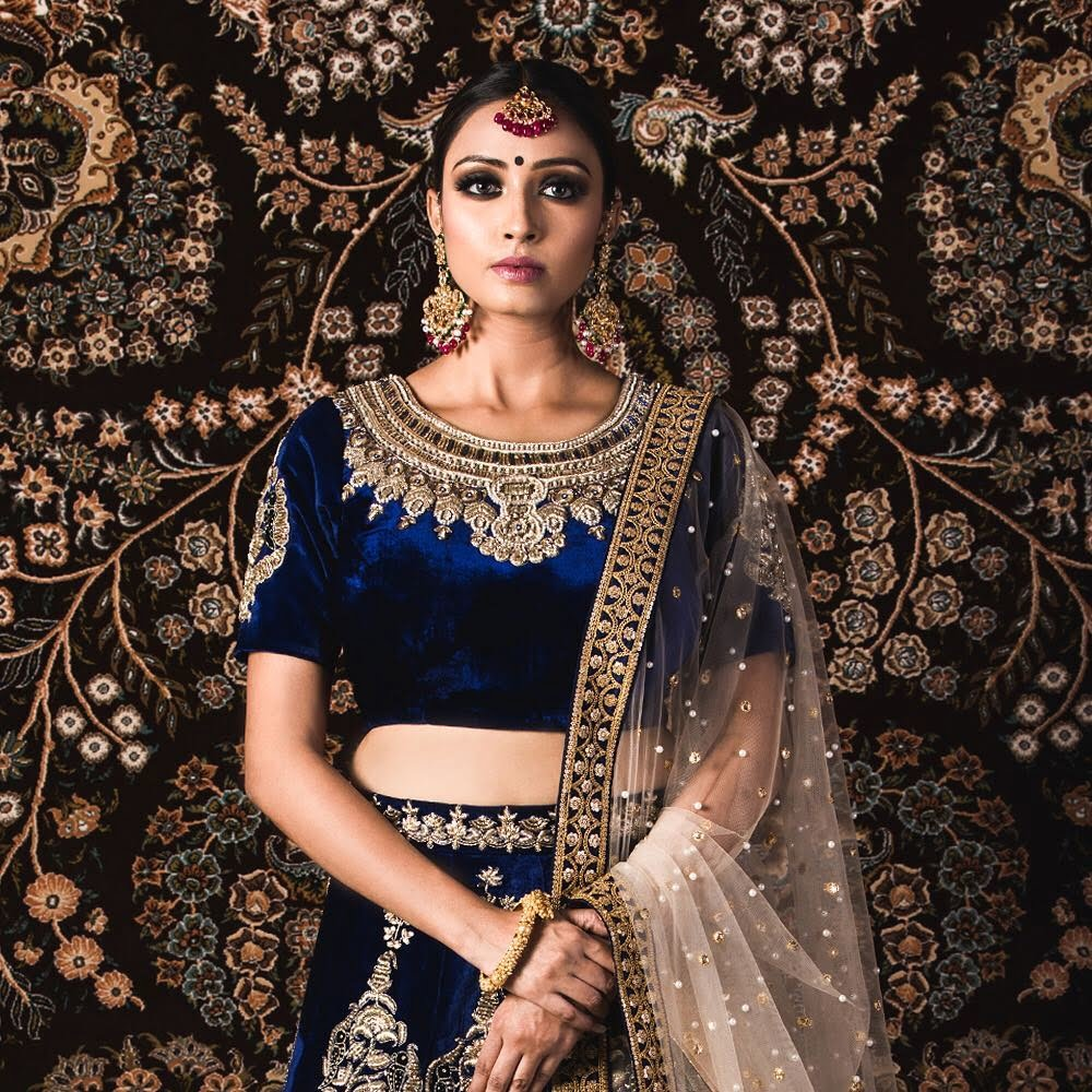 Navy blue velvet lehenga blouse with zardozi work.