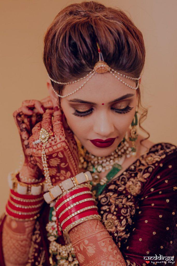 Pale brown glitter bridal eye makeup with high hair bun