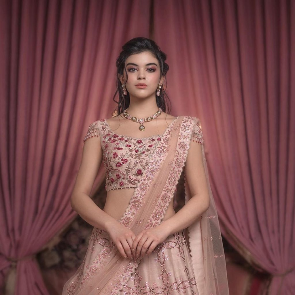 Pastel pink bridal lehenga with tassel details