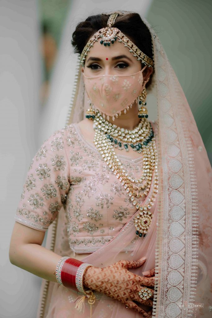 offbeat pastel indian wedding face mask with hanging small stones