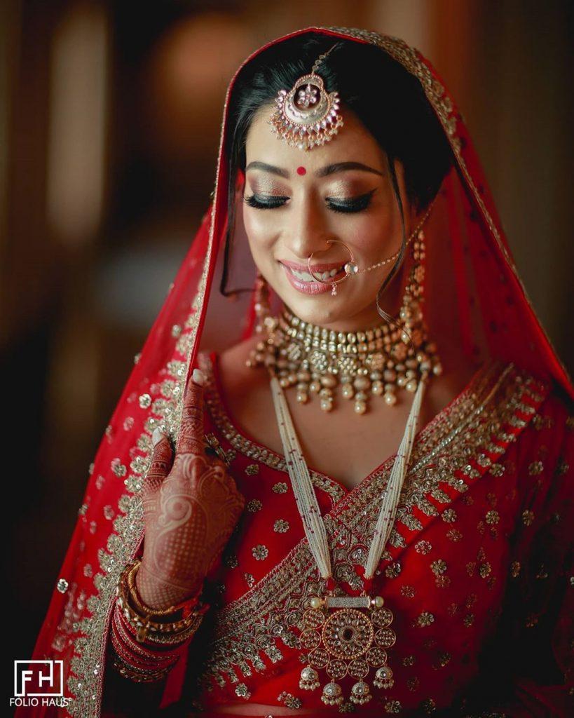 Priya Chopra's Nude pink glossy eyes with thick winged liner