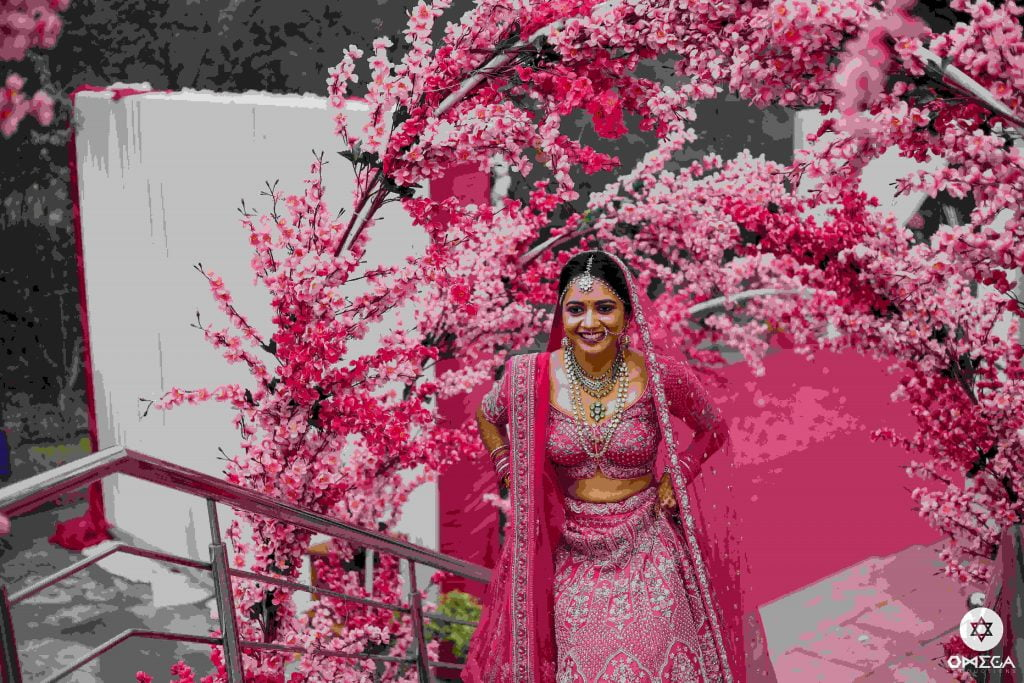 Rani pink lehenga blouse design with distinctive hemline
