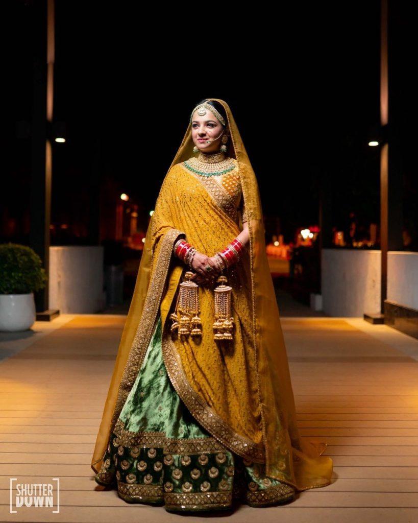 Mrighna's Solo Bridal Portrait in Gold Sabyasachi Bridal Attire for Her Beach Wedding in Dubai