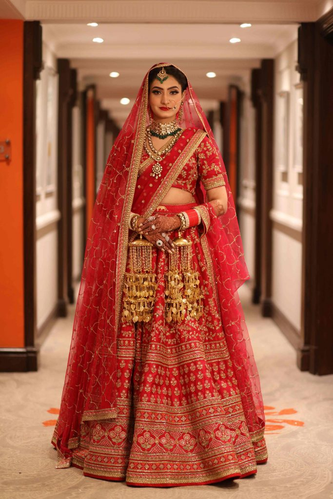 Our bride looks jaw dropping gorgeous in her Sabyasachi Mukherjee lehenga.