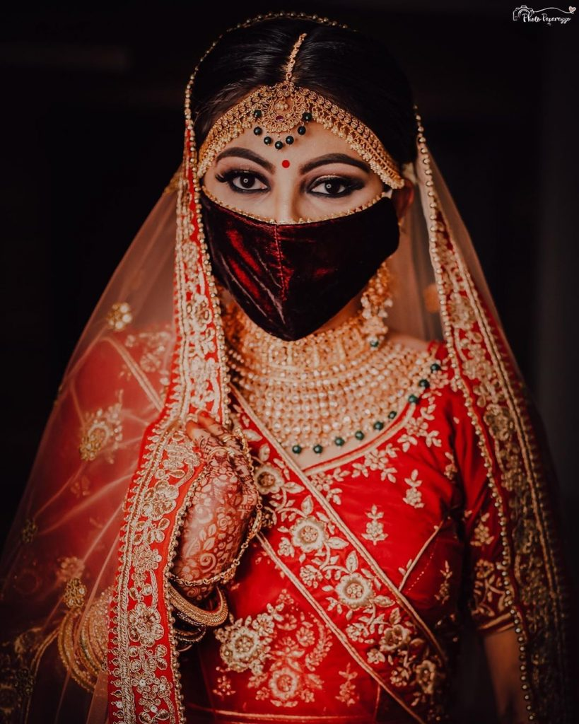 velvet red bridal face mask with kohl eye makeup and bold brows