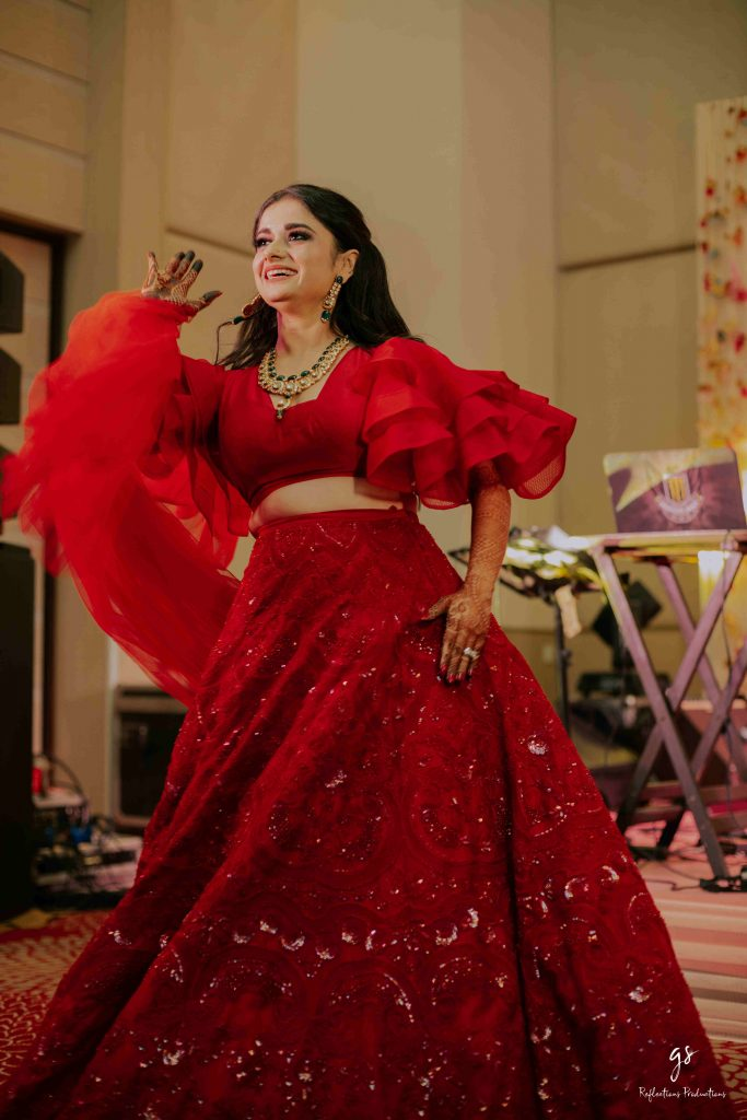 This bride opted for a stylish lehenga choli design and looked glamorous at her reception ceremony.