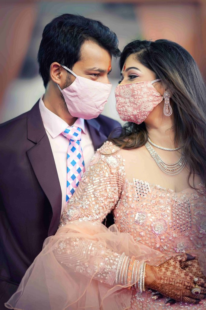 couple posing with plain and embroidered face masks