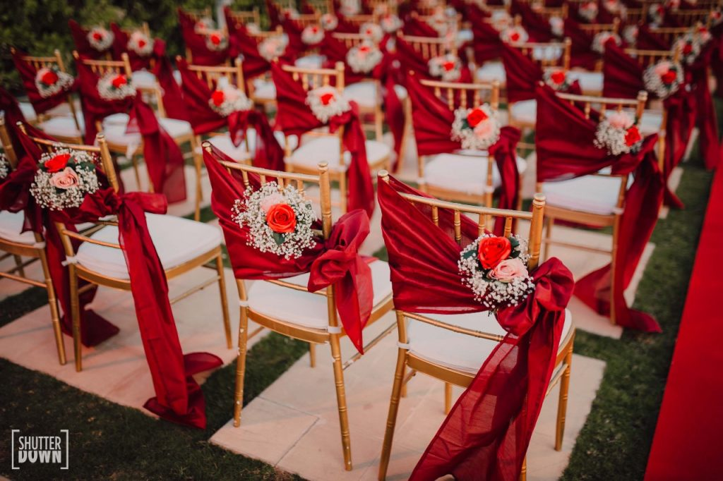 Red Theme Floral Guest Chair Decor at Mrighna & Shallabh's Red & Gold Themed Beach wedding in Dubai