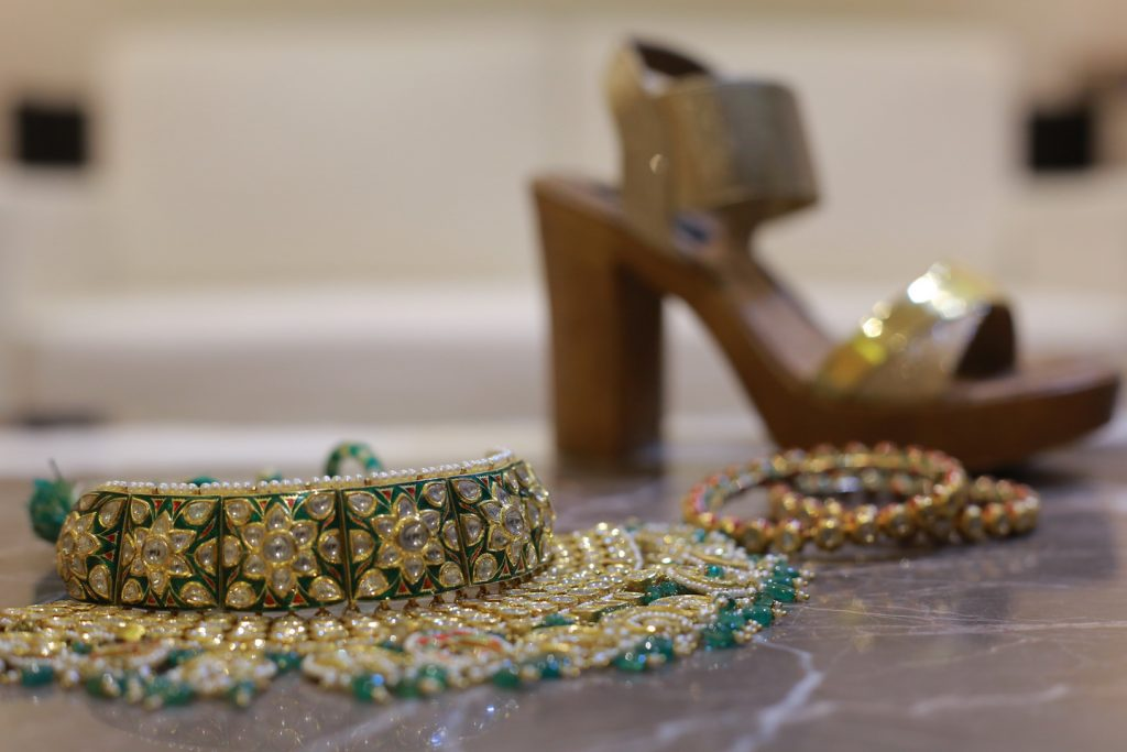 golden green wedding choker with bridal footwear