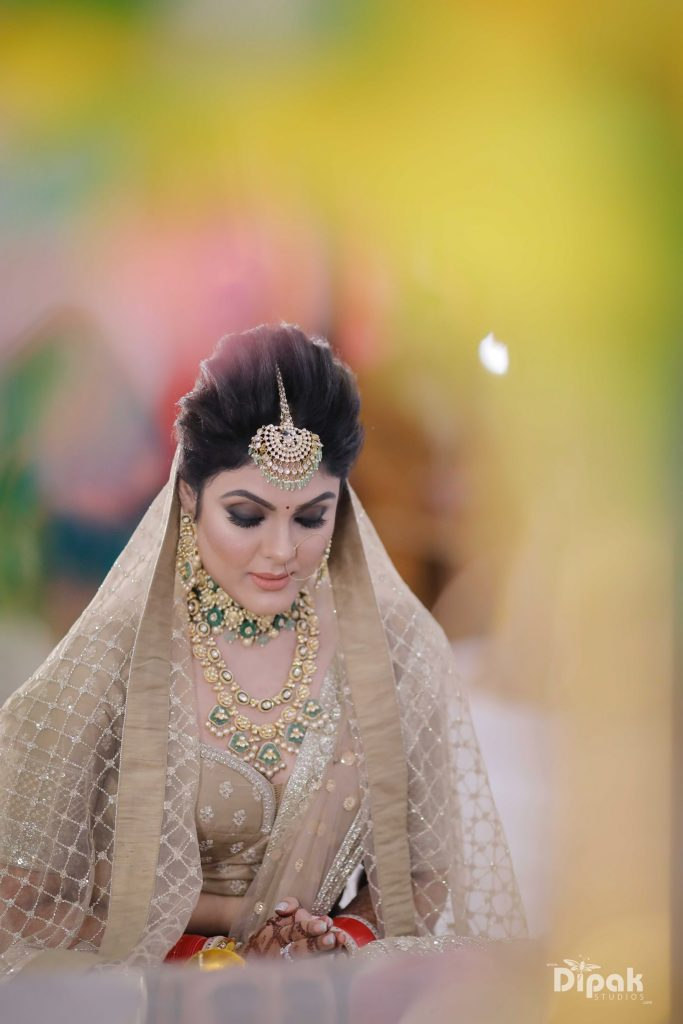 bridal bold black and brown matte smokey eye makeup with beige bridal lehenga