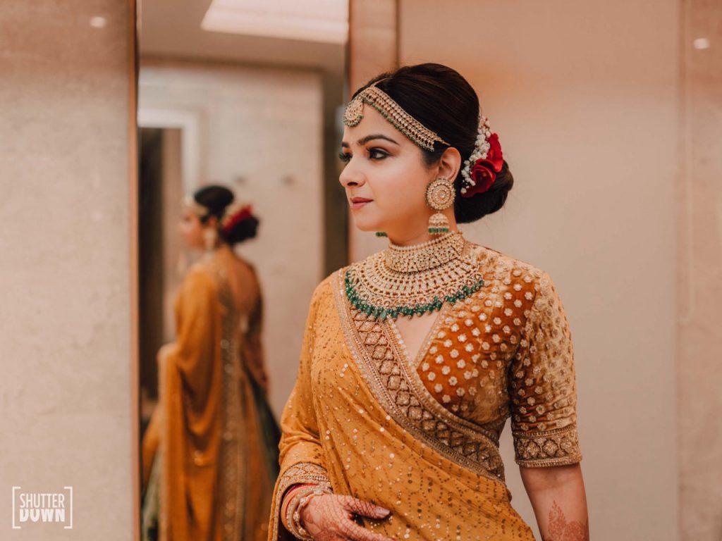 bridal photoshoot in golden sabyasachi lehenga with bridal jewellery by Maya Sanghvi