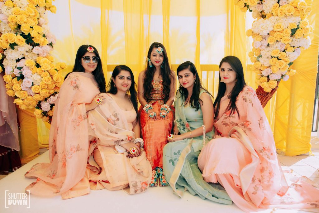 Picture of Mrighna & Bridesmaids in coordinated pastel outfits in Shades of Sunrise themed haldi ceremony for this beach wedding in Dubai