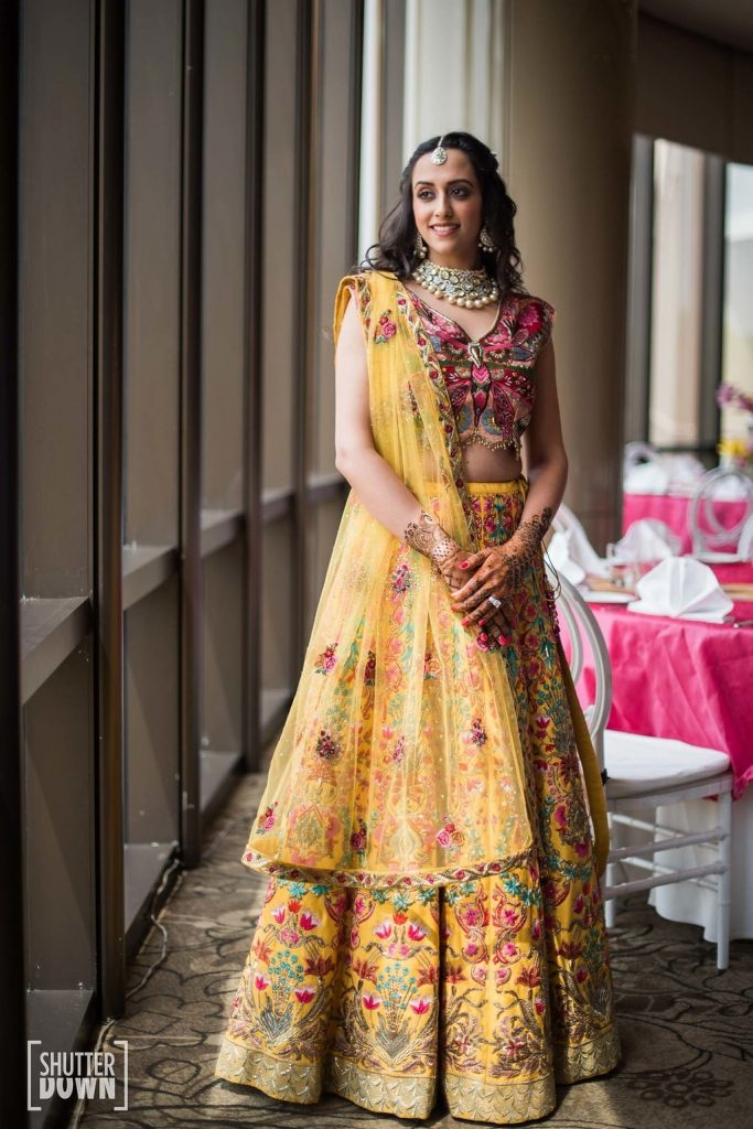 Bright colour lehenga with beaded hangings, perfect for mehendi fuction