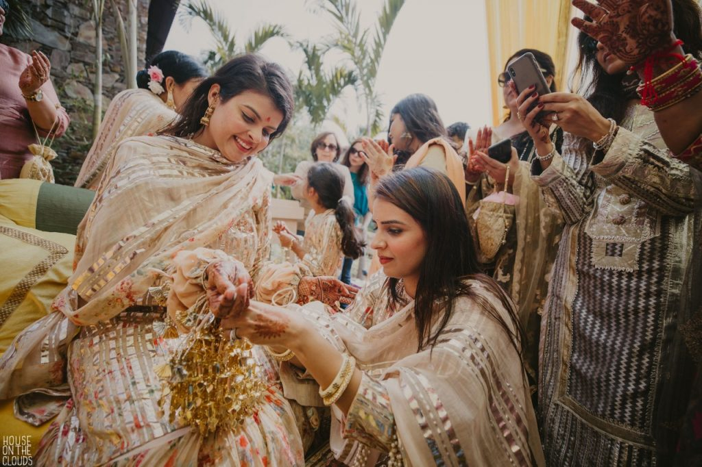 Palaks pastel pink choora ceremony candid photography