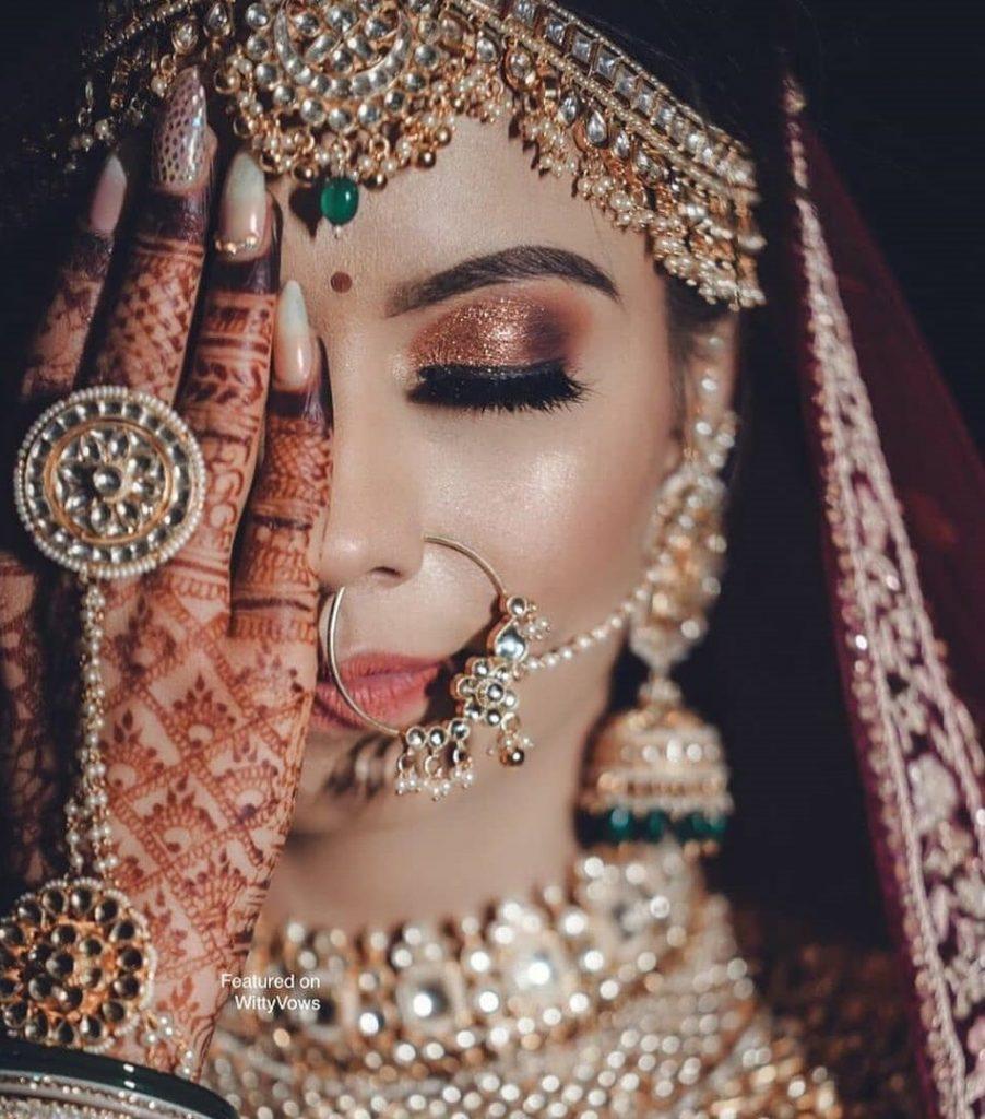 Priya Chopra's copper glitter bridal eye makeup