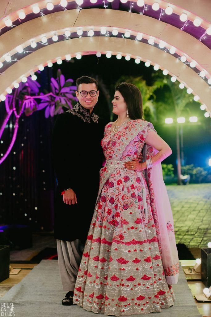 Palak & Pankaj portrait photography for lavish sangeet ceremony in bridal designer wear