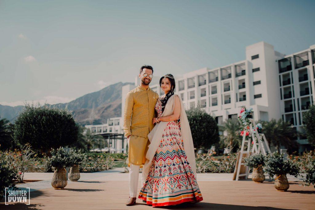 mehendi groom yellow kurta by Rajat Suri and white bridal lehenga by Tarun Tahiliani