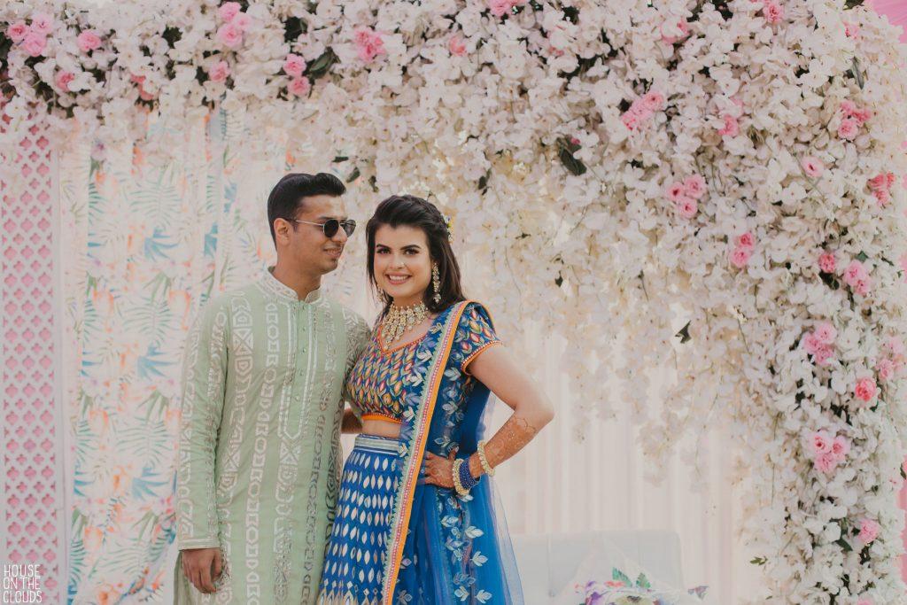 Palak & Pankaj in designer bridal wear for cute mehendi ceremony couple photography