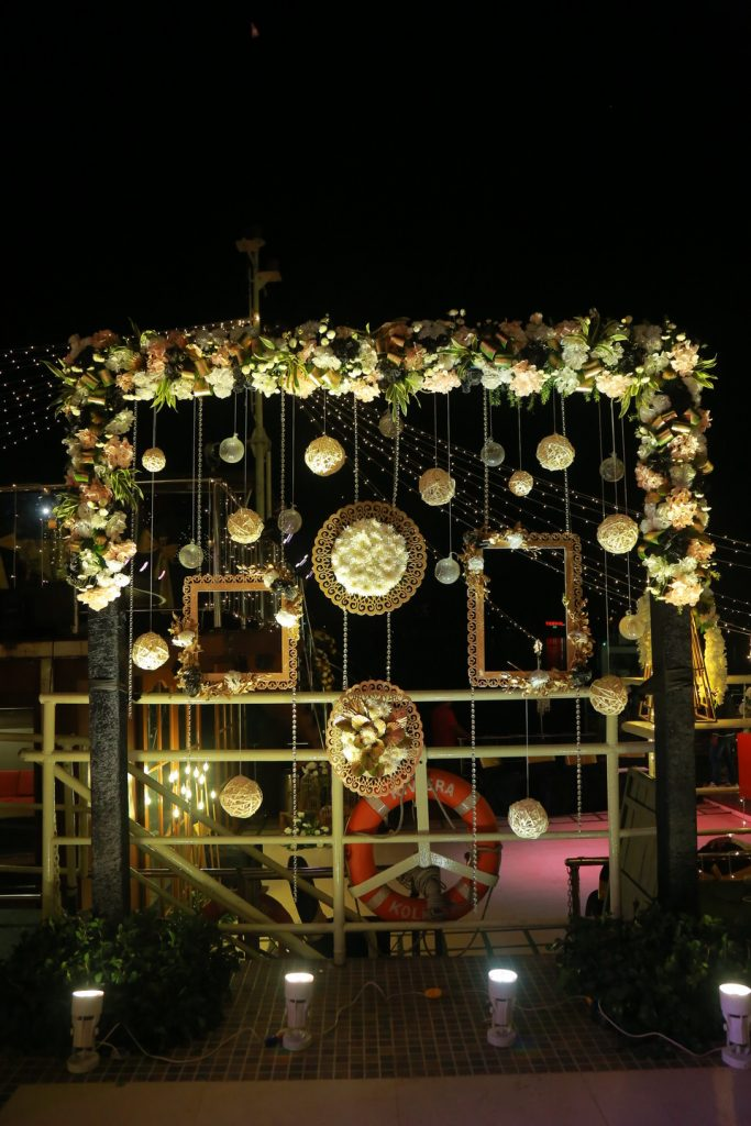 white flowers and golden decoration for sangeet ceremony on a barge