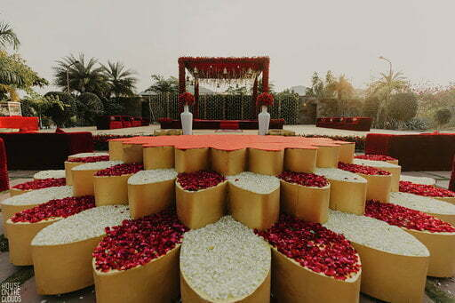 red and white flower decoration for open haldi stage