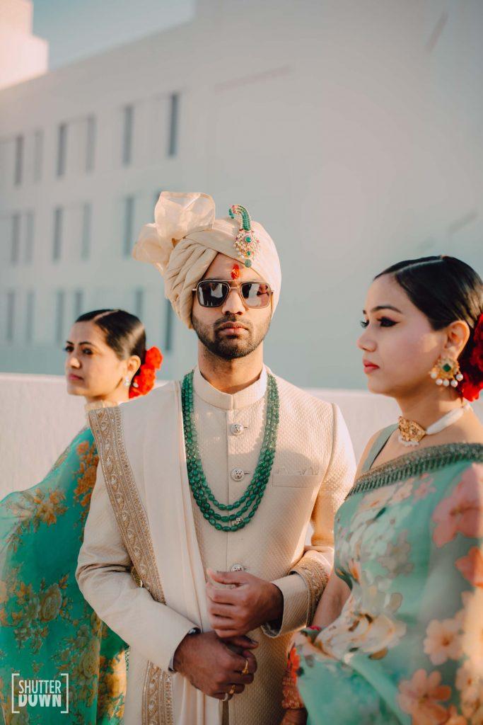 groom sabyasachi sherwani with men green wedding turban sarpeech and beaded necklace