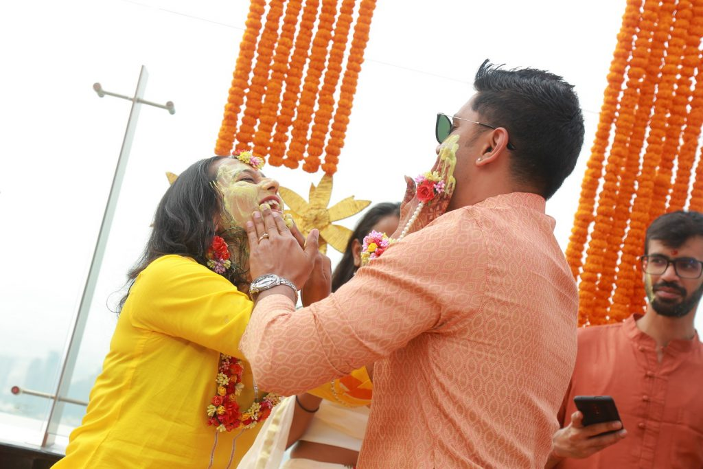 candid picture of fun haldi ceremony event