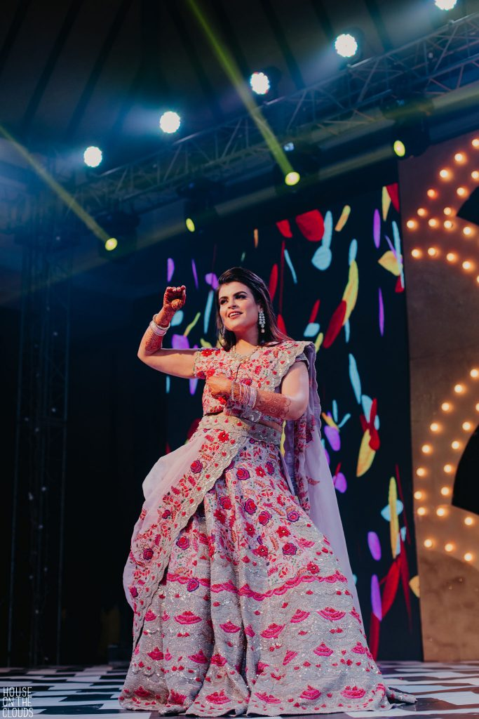 Palak candid dancing sangeet portrait in embroidered floral pink sangeet bridal designer dress by Anamika Khanna