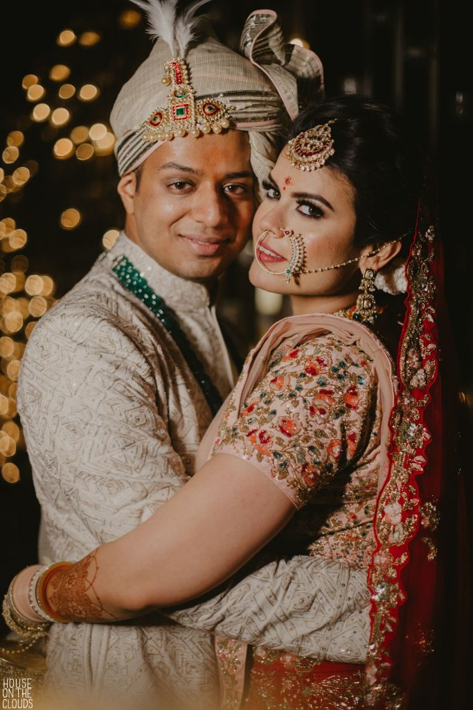 Palak & Pankaj hugging for their adorable wedding photoshoot in Udaipur