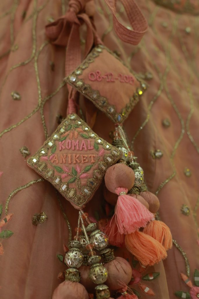 bride and groom's wedding date and name embroidered on lehenga latkan