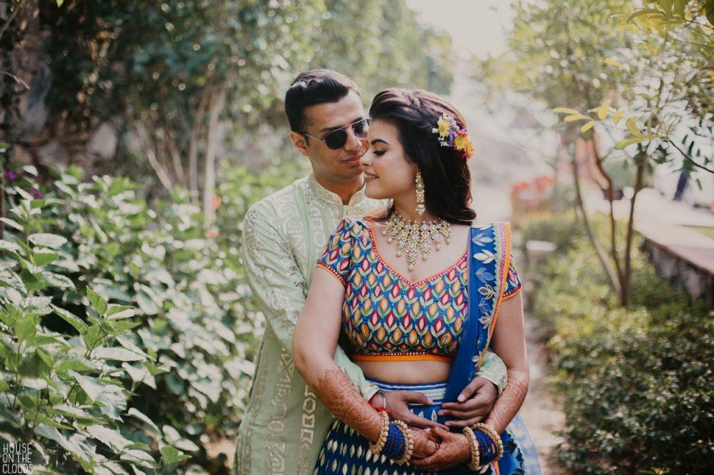 Cute Palak & Pankaj Mehndi Photography in bridal designer dresses