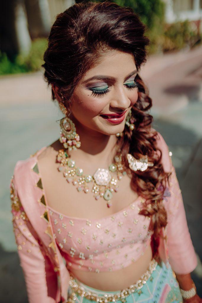 blue pink soft eye makeup for poolside bridal events
