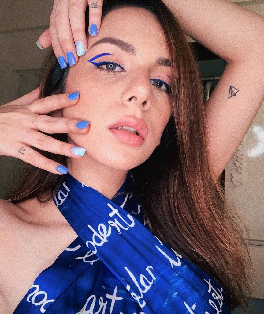 Nitibha Kauls solid blue nail with marble art